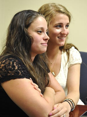 Lauren Mesnard and Nikki von Haeger pose before they were the first same-sex couple married in Davidson County.