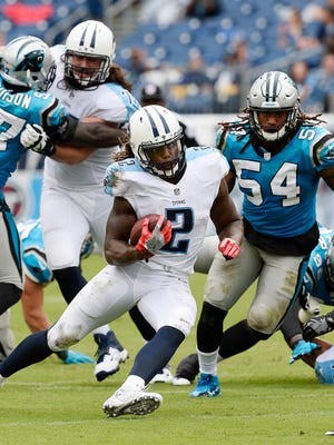 Tennessee Titans running back Derrick Henry (2) runs against the Carolina Panthers during the second half of an NFL preseason football game, Saturday at Nissan Stadium.