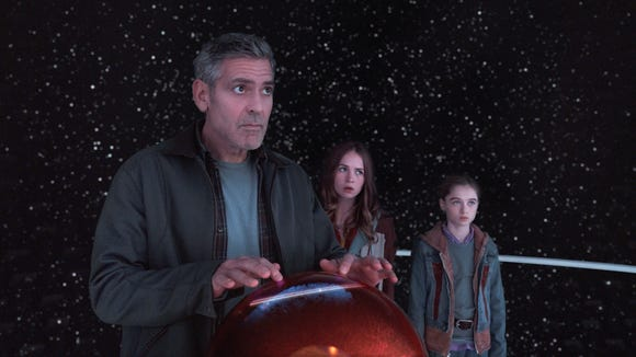 """Frank Walker (George Clooney), Casey (Britt Robertson) and Athena (Raffey Cassidy) in a scene from the motion picture """"Tomorrowland."""" CREDIT: Walt Disney Pictures [Via MerlinFTP Drop]"""