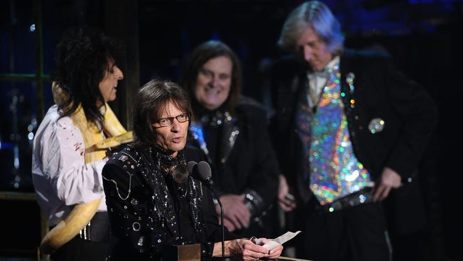 Inductees Alice Cooper, Dennis Dunaway, Michael Bruce and Neal Smith of Alice Cooper Band pose with a snake and accept their award onstage at the 26th annual Rock and Roll Hall of Fame Induction Ceremony at The Waldorf=Astoria on March 14, 2011 in New York City.
