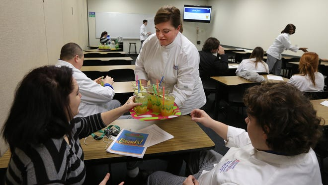 "Wendy Stuart serves ""mocktails"" (non-alcoholic cocktails) at Sullivan University in a class taught by Albert Schmid.  The class teaches about the beverage side of the food service industry.