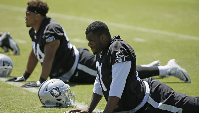 Oakland Raiders defensive end Greg Townsend Jr., left, and defensive end Shilique Calhoun, right, during the team's football minicamp Wednesday, June 15, 2016, in Alameda, Calif. (AP Photo/Eric Risberg)