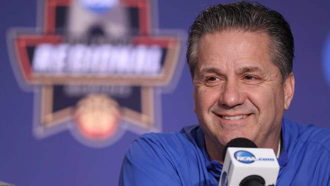 John Calipari smiles during a March 2017 press conference.