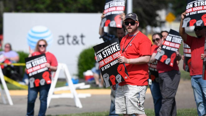 AT&T workers demonstrate along Vogel Road in Evansville, Friday, May 19, 2017.