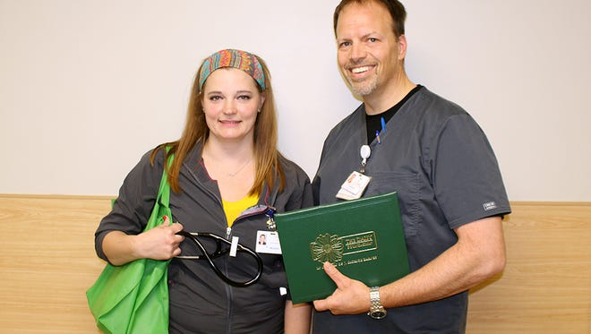 Teasha Buduen, RN, and Dale Thomas, RN
