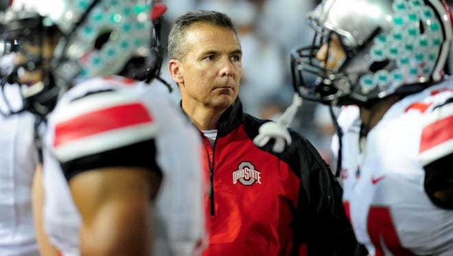 Ohio State Buckeyes head coach Urban Meyer (center) looks on during a game Oct. 25 against Penn State.