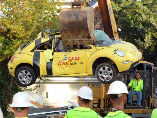 A yellow Volkswagen Beetle that once sat outside Earl Bradley's BayBees office in Lewes is crushed in 2011.