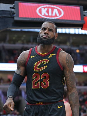 Cleveland Cavaliers forward LeBron James reacts after scoring a basket during the first quarter against the Chicago Bulls.