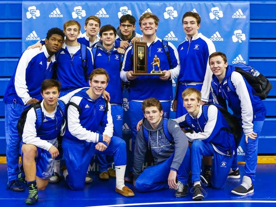 Catholic Central captured its 23rd consecutive league wrestling title.