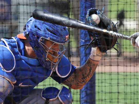 Mets catcher Tomas Nido gets grazed by a bat as he