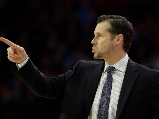 Sacramento Kings head coach David Joerger points to his team during the first half of an NBA basketball game against the Philadelphia 76ers, Tuesday, Dec. 19, 2017, in Philadelphia. (AP Photo/Matt Slocum)
