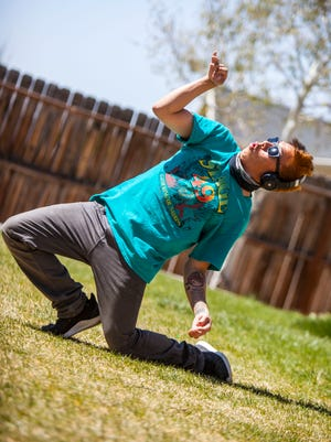 Amadeo Wauneka works on his animation dance moves Thursday at his home in Cedar City. He will performing at the Gathering of Nations in Albuquerque, New Mexico, at the end of April.