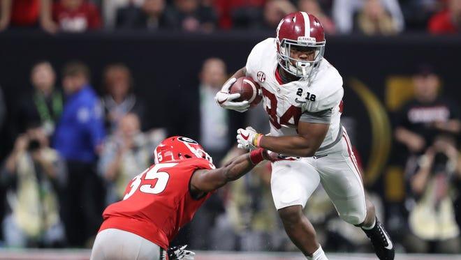 Alabama running back Damien Harris escapes Georgia defensive back Aaron Davis during the national title game Monday night in Atlanta.