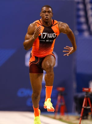 Devin Funchess runs the 40-yard dash Saturday at the NFL combine.