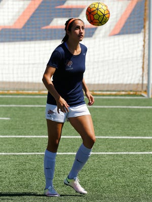 UTEP senior midfielder Brianna Barreiro of El Paso, keeps her eye on the ball during  Thursday afternoon's practice as the women's soccer team prepares for the teams season opener against NMSU August 19 at University Field.