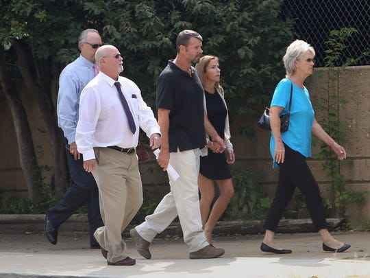 September 9, 2016 - Jeremy Drewery (center) is seen leaving after his court hearing in U.S. District Court in Memphis. Drewery, a former Shelby County Sheriff's deputy, is charged with threatening a victim with arrest for money.
