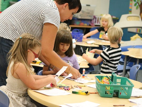 Sara Stahl helps soon-to-be Port Clinton students get acclimated to the classroom at Bataan Primary School on Friday for 'Kindergarten Camp.'