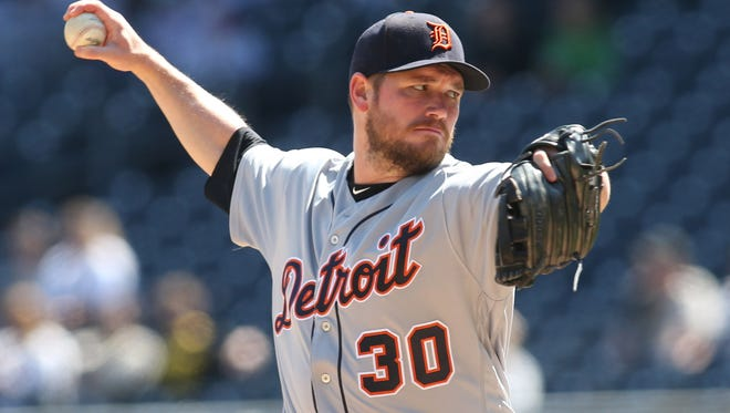 Tigers pitcher Alex Wilson (30) pitches against the Pirates during the ninth inning of the Tigers' 1-0 loss on Thursday, April 26, 2018, in Pittsburgh.