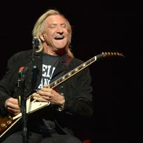 Joe Walsh, of the Eagles, performs on the History of the Eagles tour at the Forum in Los Angeles in January 2014.