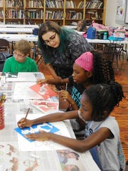 Victoria DeBlasio works with campers to create artworks inspired by Futurism.