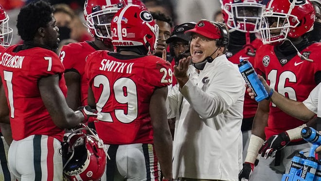 Oct 3, 2020; Athens, Georgia, USA; Georgia Bulldogs head coach Kirby Smart talks to defensive back Christopher Smith (29) during the game against the Auburn Tigers during the second half at Sanford Stadium. Mandatory Credit: Dale Zanine-USA TODAY Sports