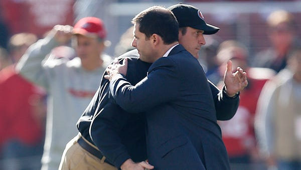 Jim Harbaugh hugs 49ers owner Jed York before Sunday's game.