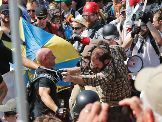 White nationalist demonstrators class with counter