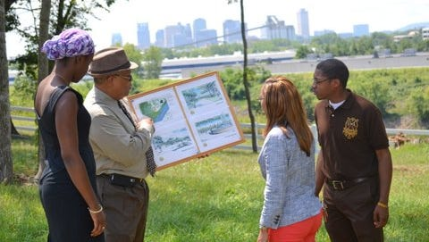 American Baptist College Executive Vice President Richard E. Jackson showing off the school's preliminary plans for the 30 acres on its campus.