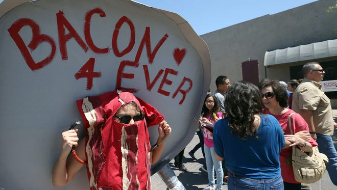 Anell Hernandez dressed as a slice of bacon Sunday at the second annual Sun City Bacon Fest at Union Plaza.