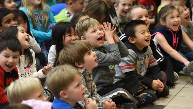 """Silver Springs Elementary School students react with laughter to puppeteer Richard Paul during his Jan. 10 visit to the school for his """"Diversity is Cool"""" presentation."""