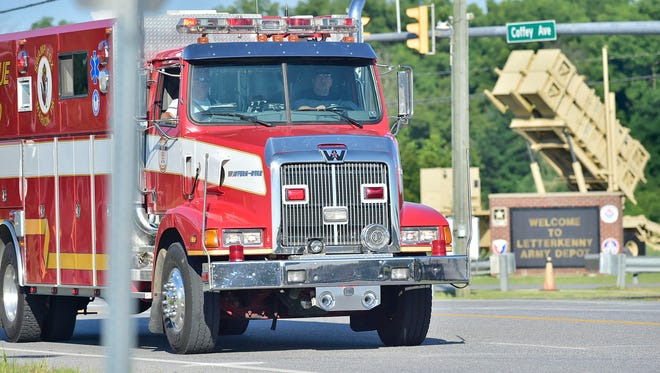 An emergency vehicle drives along Coffey Av. in front of LEAD. An explosion was reported at around 7 a.m. Thursday morning, July 19, 2018  at Letterkenny Army Depot, Chambersburg, Pa. Injuries were reported at Building 350 and air medical responded to tthe scene.