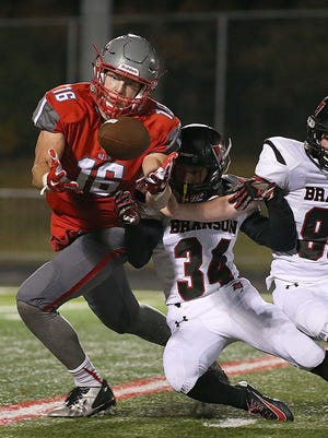 Nixa senior Chase Allen (left) caught 33 passes for 654 yards and seven touchdowns his senior year.