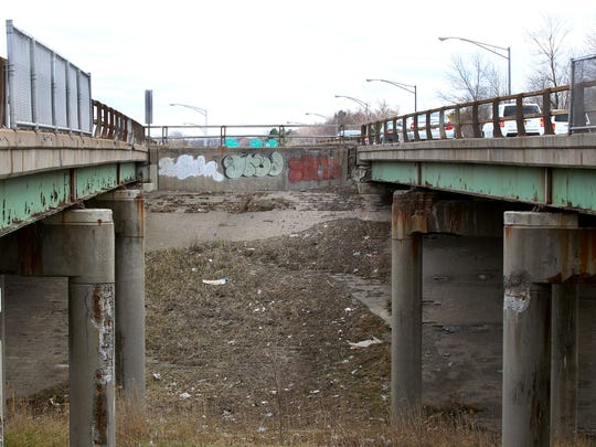 Deterioration shows on bridge carrying traffic on Route 390 over Trolley Boulevard in Gates.