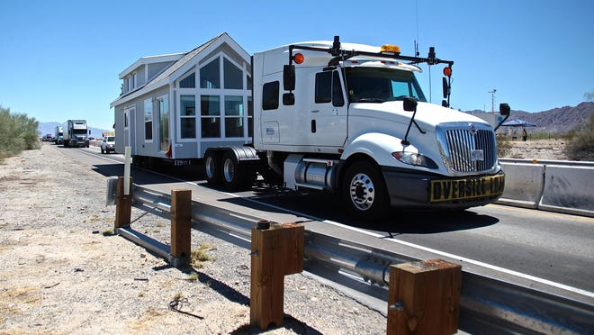 A big rig towing a mobile home was in a long line of motorists on July 24, 2015 after Caltrans workers rerouted all traffic through the westbound 1-10 Tex Wash bridge, relinking Los Angeles and Phoenix.