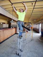 Tim Schroeder of Acoustic Professionals installs a
