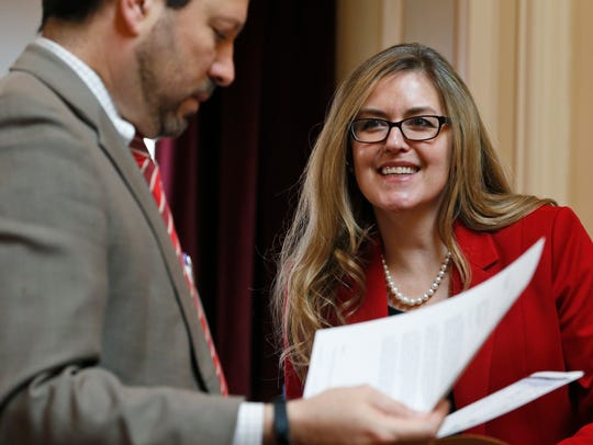 Virginia State Sen. Jennifer Wexton, D-Loudon, center, talks with Sen. Scott Surovell, D-Fairfax, left, during the Senate special budget session at the Capitol in Richmond, Va., on April 11, 2018.