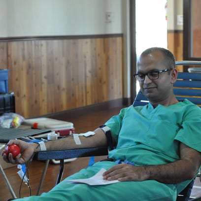 Murtaza Shakir, a surgeon at Rapides Regional Medical Center, donates blood Friday during the Islamic Society of Central Louisiana's annual blood drive.
