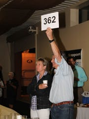 Mr. and Mrs. Lebrier bid during the live auction.