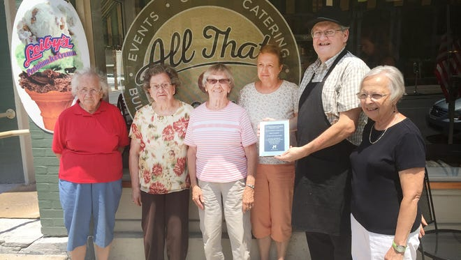 Members of the Lebanon County Woman's Christian Temperance Union present an award to All That and a Bag of Chips Owner Doug Maguire, second from right, for not serving alcohol at his restaurant at 443 Cumberland St. in Lebanon.