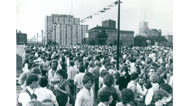 Throngs of people jam the new Center Street bridge for a party Sept. 12, 1980. The Summit County Courthouse and Stubbs Justice Center are visible in the background.