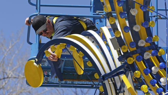 Bay Beach Amusement Park in Green Bay is getting set for its opening weekend, and the park maintenance staff was busy checking everything over Monday, May 2, 2016. Eric Perrault, a park maintenance specialist/mechanic, inspects the Scat from a lift.