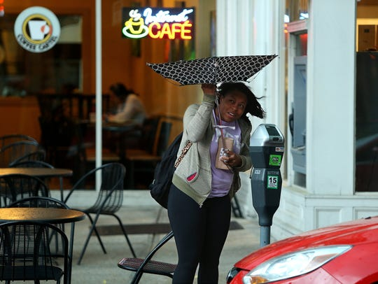 Nicole Brown of Hazelwood tries to save her umbrella