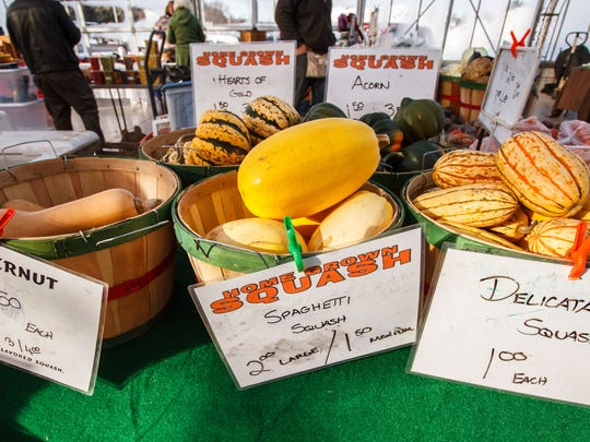 Fresh squash from Wit's Vegetable Farm of Cedarburg are an example of the local organic produce available at the Oconomowoc Winter Farmers Market on Sunday, Jan. 10, 2016.
