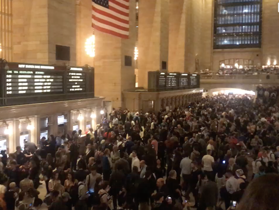 Commuters wait in Grand Central Terminal in New York