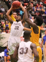 Pensacola's devin Gadson goes up for a basket as Largo's Dakari Allen and Isaiah Bellamy try to block during the FHSAA 6A semi final Friday February 26, 2016 in Lakeland, Florida. Pensacola lost the match 54-56. Photos by Cindy Skop 2016