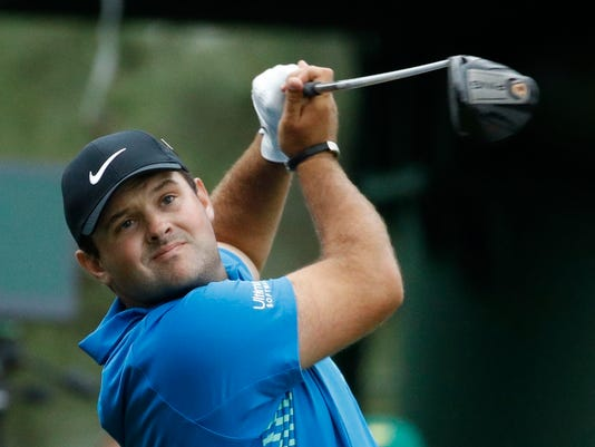 Patrick Reed hits a drive on the 18th hole during the third round at the Masters golf tournament Saturday, April 7, 2018, in Augusta, Ga. (AP Photo/Charlie Riedel)