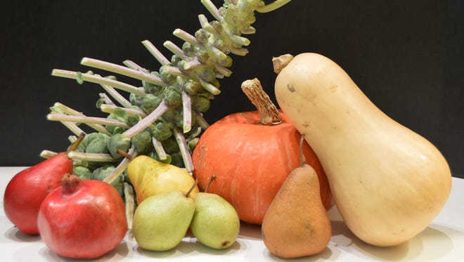 Pears, pomegranates, brussels sprouts (on the stalk) and fall squash like sunshine (orange) and butternut are favorites among fall produce.