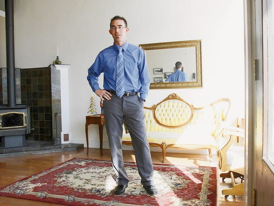 Attorney Ryan Lane poses for a portrait on Tuesday at his new office at 103 S. Main St. in Aztec.