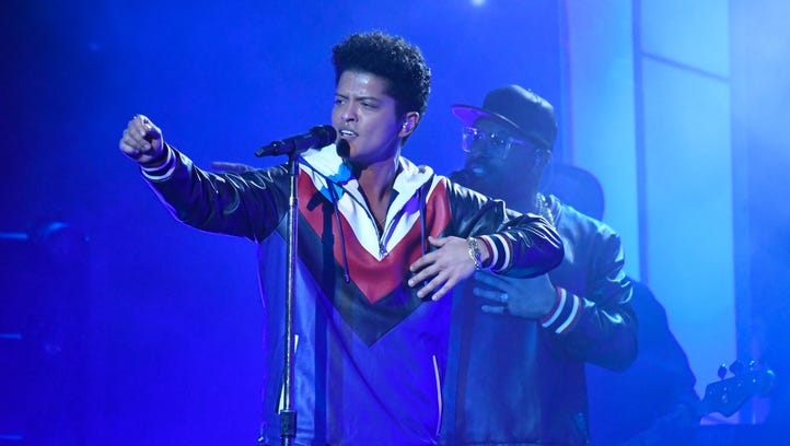 Bruno Mars perform during the 59th Annual Grammy Awards