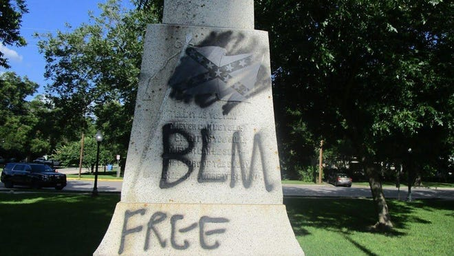 """The letters """"BLM"""" and the phrase """"Free Rodney Reed"""" were found painted on the Confederate monuments in front of the Bastrop County Courthouse  on June 7."""